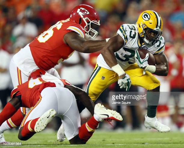 running back Aaron Jones of the Green Bay Packers carries the ball during the preseason game against the Kansas City Chiefs at Arrowhead Stadium on...