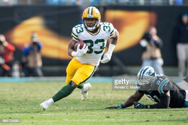 Running back Aaron Jones of the Green Bay Packers carries the ball against the Carolina Panthers during a NFL game at Bank of America Stadium on...