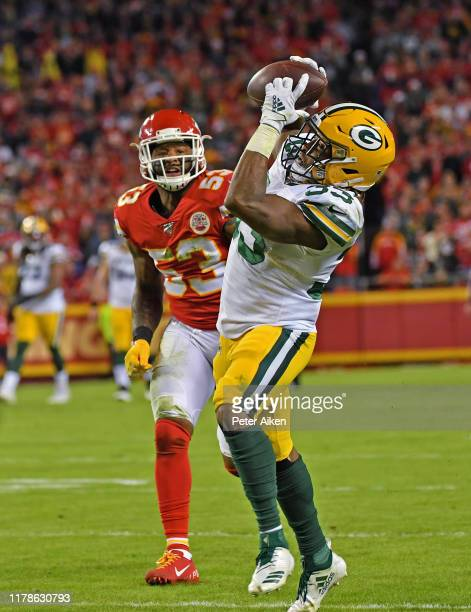 Running back Aaron Jones of the Green Bay Packers catches a pass against inside linebacker Anthony Hitchens of the Kansas City Chiefs during the...