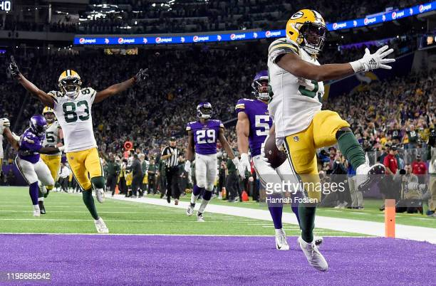 Running back Aaron Jones of the Green Bay Packers celebrates after rushing for a touchdown in the fourth quarter of the game against the Minnesota...