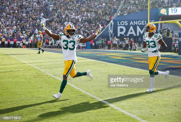 Running back Aaron Jones of the Green Bay Packers celebrates in the game against the Los Angeles Rams at Los Angeles Memorial Coliseum on October 28...