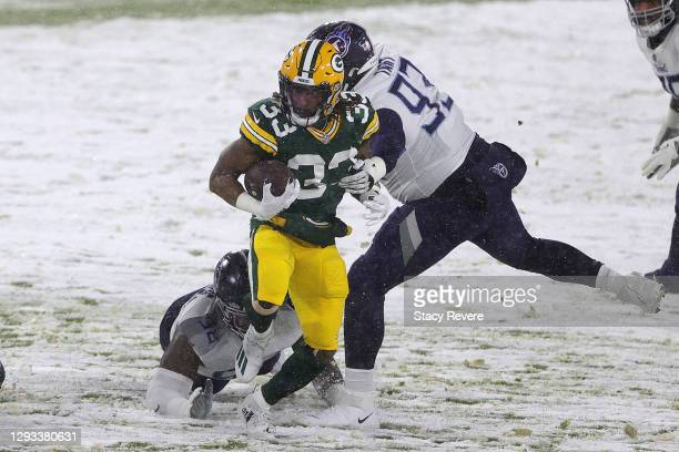 Running back Aaron Jones of the Green Bay Packers runs against the Tennessee Titans during the first quarter at Lambeau Field on December 27, 2020 in...