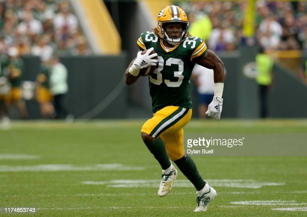 Running back Aaron Jones of the Green Bay Packers runs the ball against the Minnesota Vikings in the first quarter during the game at Lambeau Field...