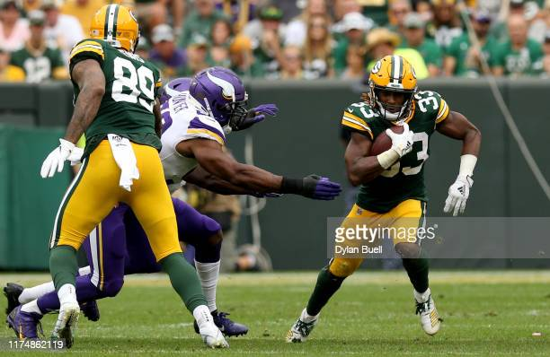 Running back Aaron Jones of the Green Bay Packers runs the ball against the Minnesota Vikings in the game at Lambeau Field on September 15 2019 in...