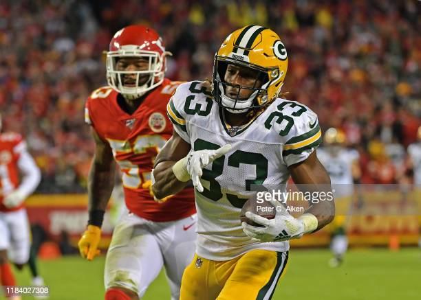 Running back Aaron Jones of the Green Bay Packers runs up field after catching a pass against inside linebacker Anthony Hitchens of the Kansas City...