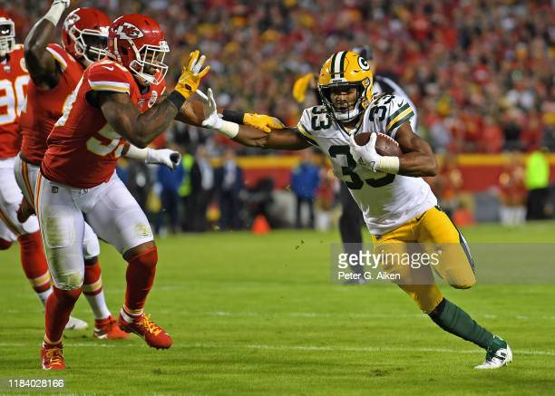 Running back Aaron Jones of the Green Bay Packers runs up field against inside linebacker Anthony Hitchens of the Kansas City Chiefs during the first...