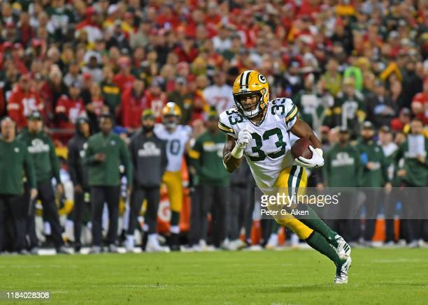 Running back Aaron Jones of the Green Bay Packers runs up field against the Kansas City Chiefs during the first half at Arrowhead Stadium on October...