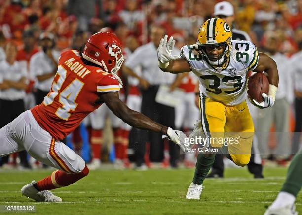 Running back Aaron Jones of the Green Bay Packers rushes down field against defensive back Leon III McQuay of the Kansas City Chiefs during the first...