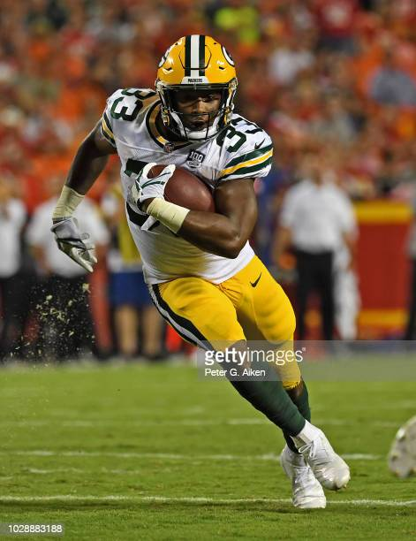 Running back Aaron Jones of the Green Bay Packers rushes down field against the Kansas City Chiefs during the first half on August 30 2018 at...