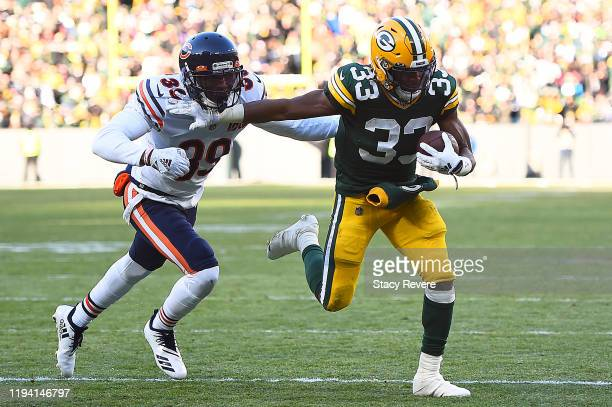 Running back Aaron Jones of the Green Bay Packers rushes for a touchdown in the third quarter over free safety Eddie Jackson of the Chicago Bears at...
