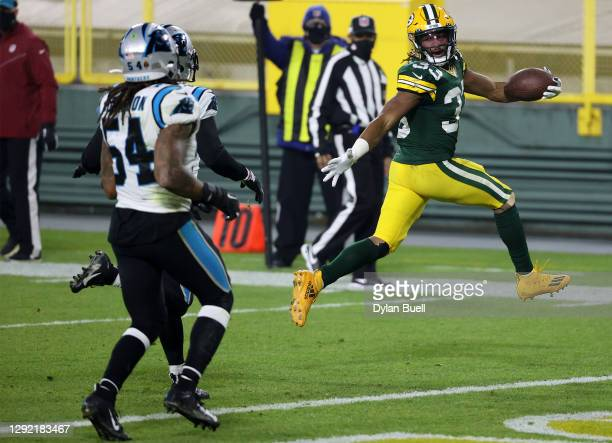 Running back Aaron Jones of the Green Bay Packers rushes for a touchdown in the second quarter of the game against the Carolina Panthers at Lambeau...