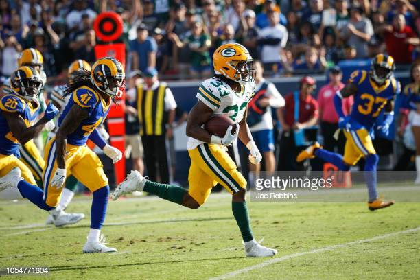 Running back Aaron Jones of the Green Bay Packers scores a touchdown at the end of the third quarter against the Los Angeles Rams at Los Angeles...