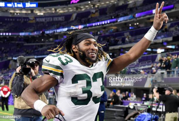 Running back Aaron Jones of the Green Bay Packers walks off the field after the 2310 win over the Minnesota Vikings at US Bank Stadium on December 23...