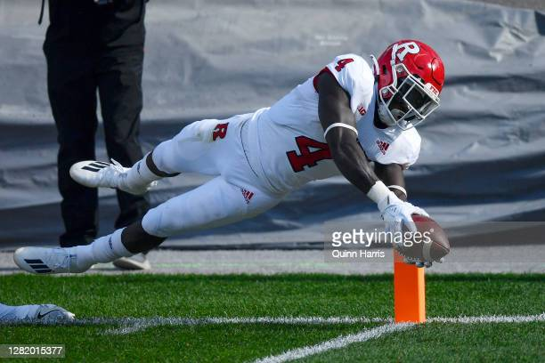 Running back Aaron Young of the Rutgers Scarlet Knights dives in the first half against the Michigan State Spartans at Spartan Stadium on October 24,...