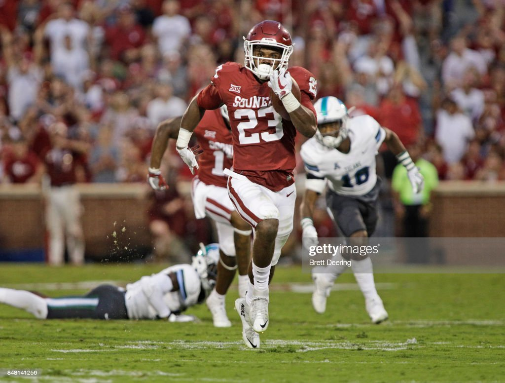 Running back Abdul Adams #23 of the Oklahoma Sooners runs downfield against the Tulane Green Wave at Gaylord Family Oklahoma Memorial Stadium on September 16, 2017 in Norman, Oklahoma. Oklahoma defeated Tulane 56-14.