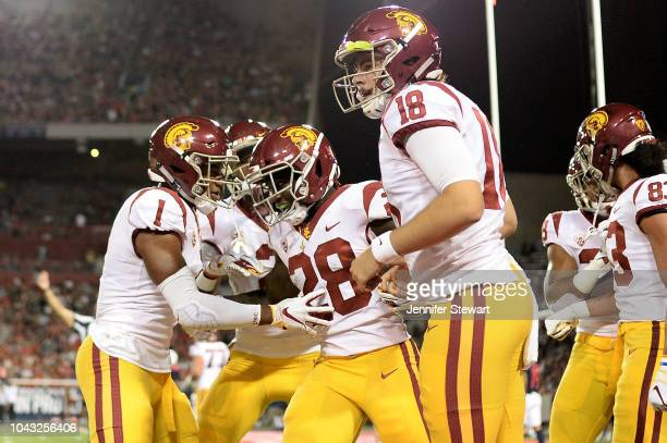 Running back Aca'Cedric Ware of the USC Trojans celebrates a 26 yard touchdown against the Arizona Wildcats in the first half at Arizona Stadium on...