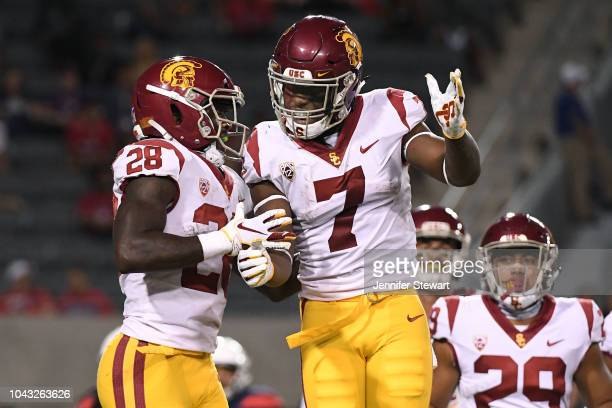 Running back Aca'Cedric Ware of the USC Trojans celebrates a 69 yard touchdown with running back Stephen Carr in the second half of the game against...