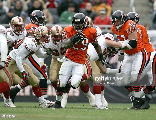 Running back Adrain Peterson of the Chicago Bears runs through the defense of the San Francisco 49ers on November 13 2005 at Soldier Field in Chicago...