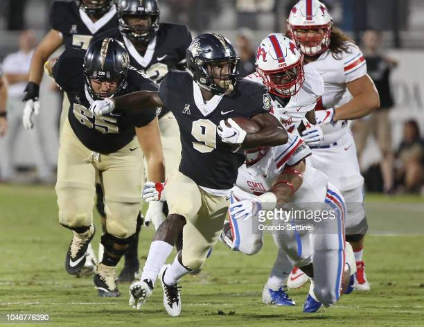 UCF running back Adrian Killins Jr carries in the first half against SMU at Spectrum Stadium in Orlando Fla on Saturday Oct 6 2018