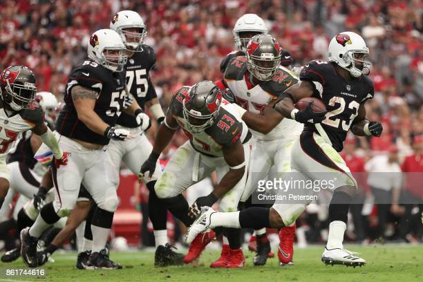 Running back Adrian Peterson of the Arizona Cardinals rushes the football past defensive tackle Gerald McCoy of the Tampa Bay Buccaneers during the...