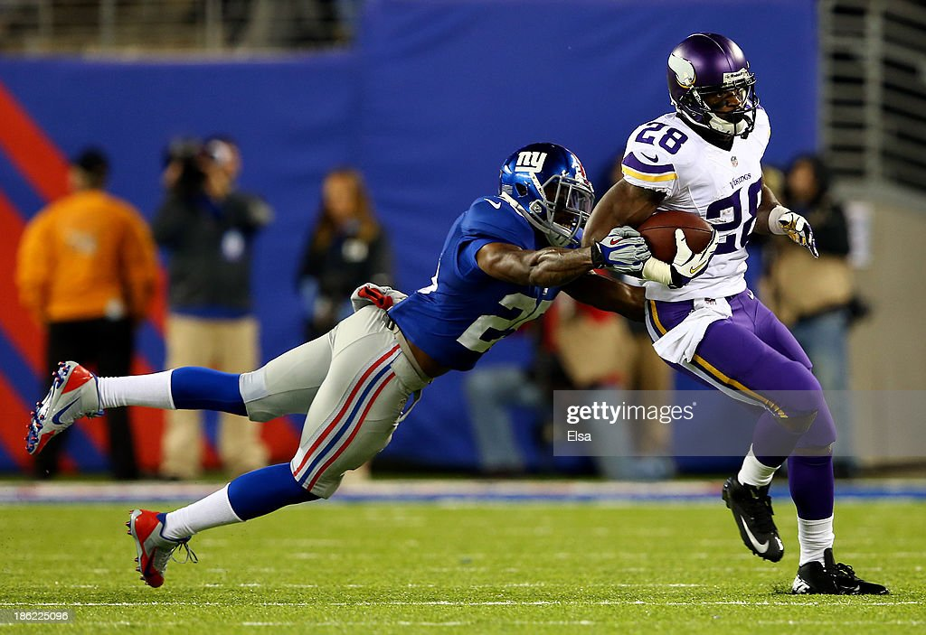 Running back Adrian Peterson #28 of the Minnesota Vikings avoids a tackle by defensive back Will Hill #25 of the New York Giants during a game at MetLife Stadium on October 21, 2013 in East Rutherford, New Jersey.