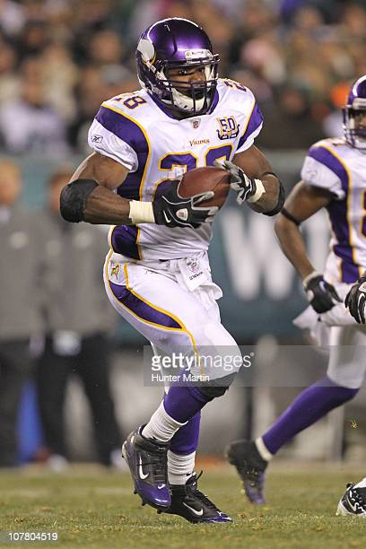 Running back Adrian Peterson of the Minnesota Vikings carries the ball during a game against the Philadelphia Eagles at Lincoln Financial Field on...