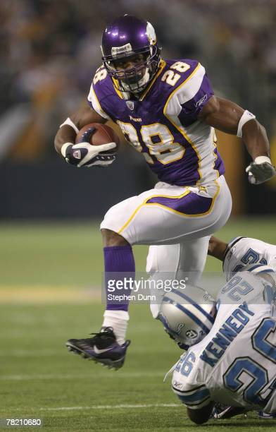 Running back Adrian Peterson of the Minnesota Vikings carries the ball against the Detroit Lions defends at the Metrodome December 2, 2007 in...