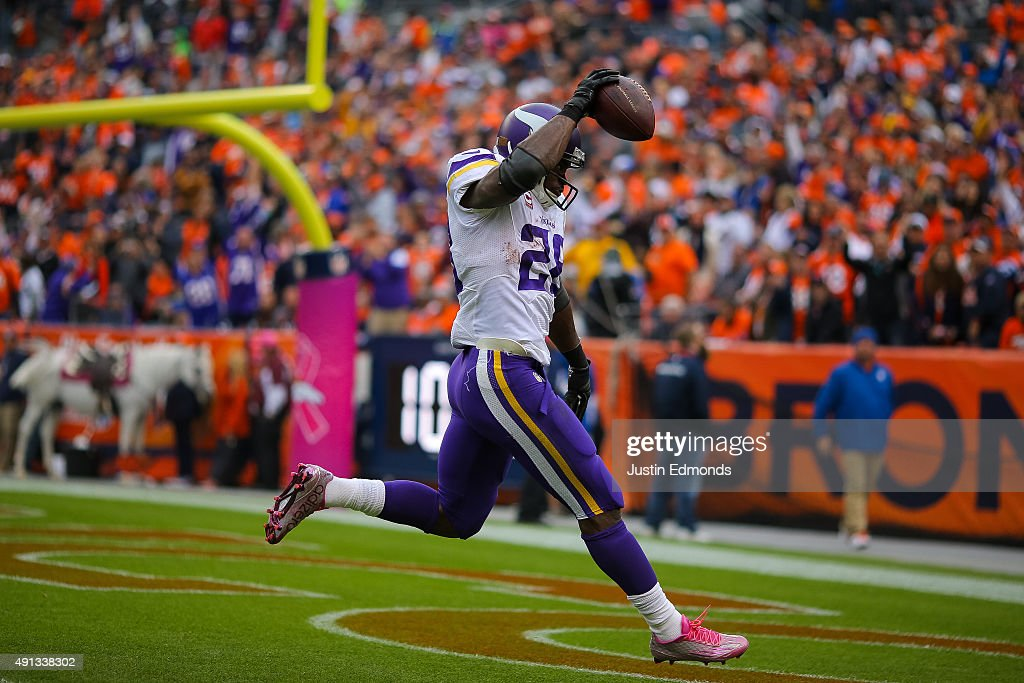 Running back Adrian Peterson #28 of the Minnesota Vikings celebrates after rushing for a 48 yard touchdown against the Denver Broncos in the fourth quarter of a game at Sports Authority Field at Mile High on October 4, 2015 in Denver, Colorado.