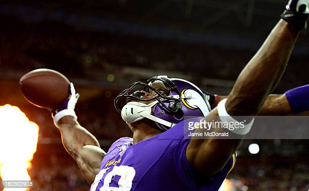 Running back Adrian Peterson of the Minnesota Vikings celebrates as he scores a touchdown during the NFL International Series game between Pittsburgh...