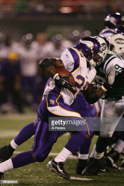 Running back Adrian Peterson of the Minnesota Vikings moving the ball against theNew York Jets at Giants Stadium August 17 2007 at the Meadowlands in...