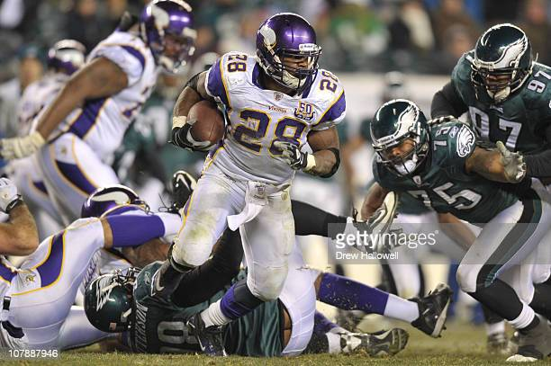 Running back Adrian Peterson of the Minnesota Vikings runs the ball during the game against the Philadelphia Eagles at Lincoln Financial Field on...
