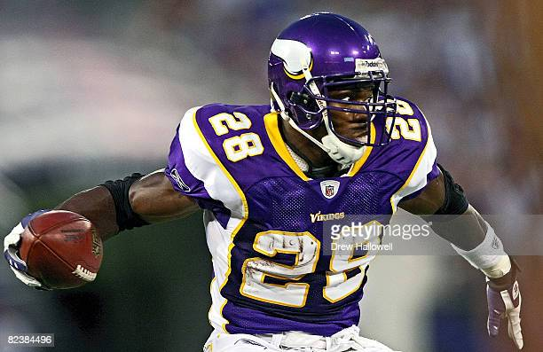 Running back Adrian Peterson of the Minnesota Vikings runs with the ball during the game against the Baltimore Ravens on August 16 2008 at M T Bank...