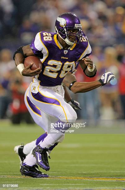 Running back Adrian Peterson of the Minnesota Vikings rushes the ball against the Baltimore Ravens during NFL action at Hubert H Humphrey Metrodome...
