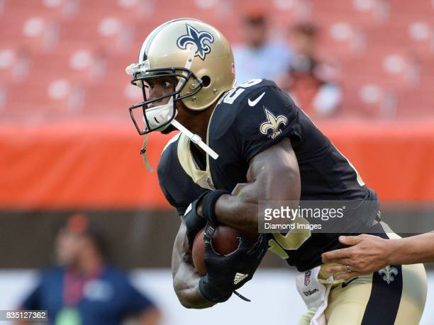 Running back Adrian Peterson of the New Orleans Saints carries the ball prior to a preseason game on August 10 2017 against the Cleveland Browns at...