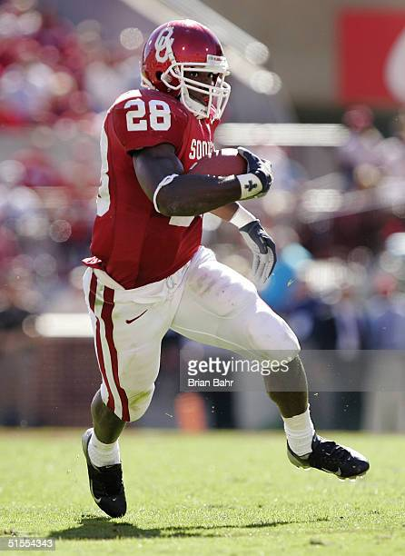 Running back Adrian Peterson of the Oklahoma Sooners kicks into gear against the Kansas Jayhawks in the fourth quarter on October 23, 2004 at...