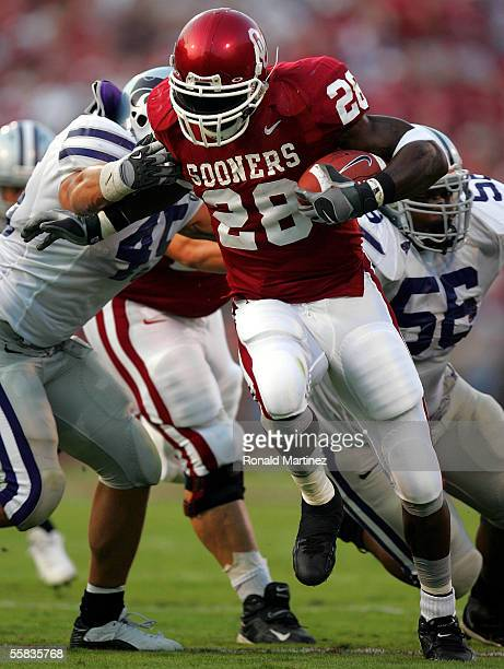Running back Adrian Peterson of the Oklahoma Sooners runs for a touchdown against the Kansas State Wildcats on October 1 2005 at Memorial Stadium in...