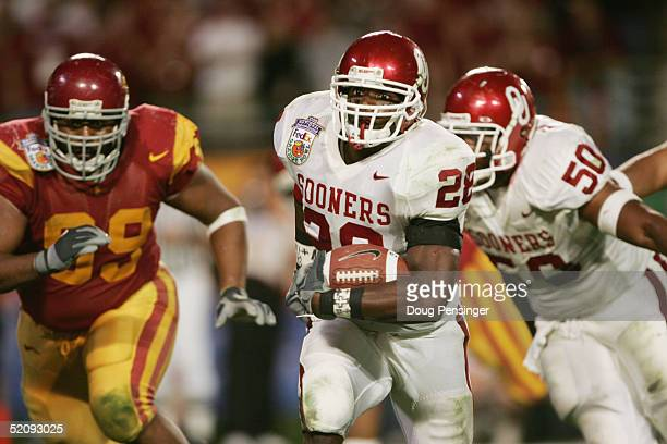 Running back Adrian Peterson of the Oklahoma Sooners runs upfield against the USC Trojans in the 2005 FedEx Orange Bowl National Championship on...