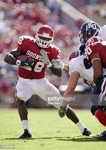 Running back Adrian Peterson of the Oklahoma Sooners shifts his direction against the Kansas Jayhawks in the fourth quarter on October 23, 2004 at...