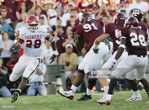 Running back Adrian Peterson of the University of Oklahoma Sooners carries the ball against the Texas AM University Aggies on November 6 2004 at Kyle...