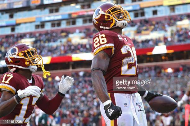 Running back Adrian Peterson of the Washington Redskins celebrates after scoring a touchdown against the Philadelphia Eagles during the fourth...