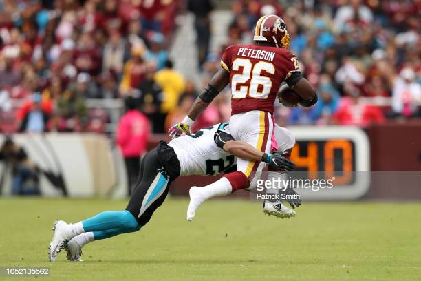 Running back Adrian Peterson of the Washington Redskins loses his shoe as he runs with the ball in the second quarter against the Carolina Panthers...