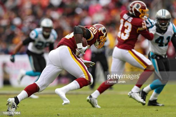 Running back Adrian Peterson of the Washington Redskins loses his shoe as he rushes with the ball against the Carolina Panthers during the second...