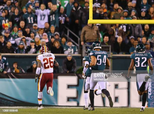 Running back Adrian Peterson of the Washington Redskins runs for a 90yard touchdown against the Philadelphia Eagles during the second quarter at...