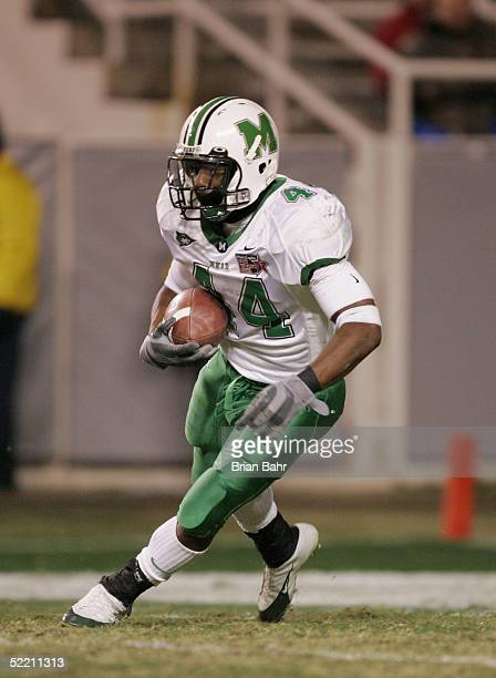 Running back Ahmad Bradshaw of the Marshall Thundering Herd runs against the Cincinnati Bearcats on December 23 2004 in the Plains Capital Fort Worth...