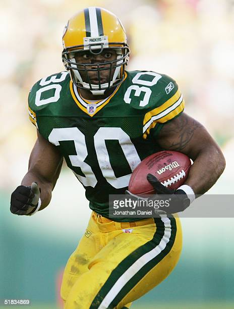 Running back Ahman Green of the Green Bay Packers carries the ball during the game against the Dallas Cowboys at Lambeau Field on October 24 2004 in...