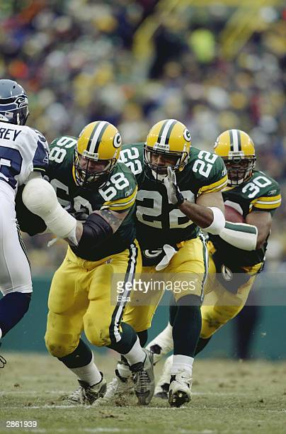 Running back Ahman Green of the Green Bay Packers runs the ball behind fullback Nick Luchey and offensive guard Mike Wahle during the NFC playoff...