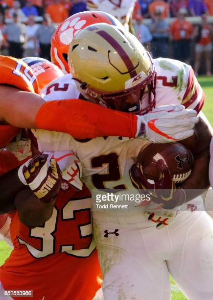 Running back AJ Dillon of the Boston College Eagles is brought down by defenders from the Clemson Tigers at Memorial Stadium on September 23 2017 in...