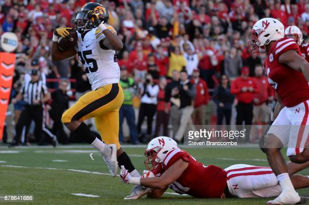 Running back Akrum Wadley of the Iowa Hawkeyes avoids the tackle of linebacker Collin Miller of the Nebraska Cornhuskers to score at Memorial Stadium...