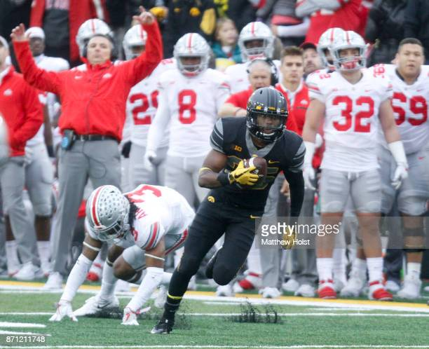 Running back Akrum Wadley of the Iowa Hawkeyes breaks a tackle during the second quarter by cornerback Damon Arnette of the Ohio State Buckeyes on...