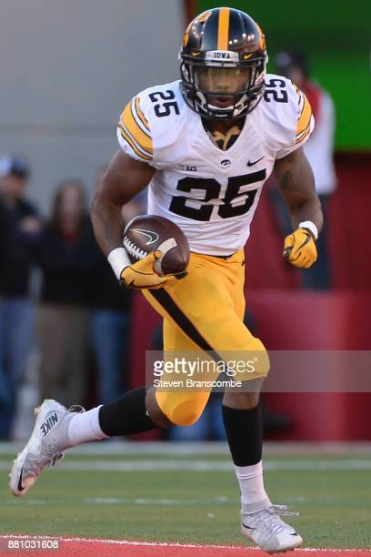 Running back Akrum Wadley of the Iowa Hawkeyes runs against the Nebraska Cornhuskers at Memorial Stadium on November 24 2017 in Lincoln Nebraska